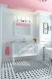 pink ceiling black white tile bathroom