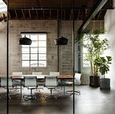 rustic modern office. architecturally the designs incorporates rustic features of antiques and flawed reclaimed wood with modern glass office