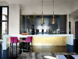 the centerpiece of designer jamie drakes new york kitchen is a custommade island comprising cabinetry finished