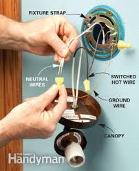 how to add a light the family handyman latest install a wall sconce light fixture