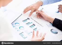 Business People Discussing Data Analysis Chart Document