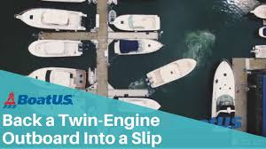 docking how to back into a slip with a twin outboard boat boatus