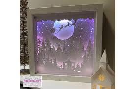 Ornament box svg cut file for handmade holiday ornaments. Santa S Cabin Paper Cut Light Box Graphic By Jumbleink Digital Downloads Creative Fabrica