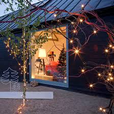 christmas outdoor lighting ideas. prelit garden branches and trees l outdoor christmas lighting ideas 2013