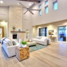 Light hardwood floors living room Home Epiphany Open Contemporary Living Room With Light Hardwood Floors And Tall Stone Fireplace Photos Hgtv Photos Hgtv