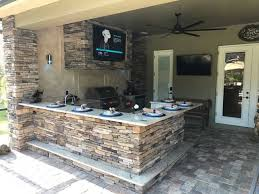 view full gallery of our stone outdoor kitchen projects