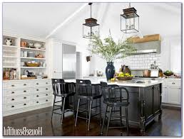 farmhouse kitchen lighting ideas pendant over kitchen island overhang for seating and bar stools white granite