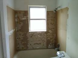 here is a picture of the cur bathroom i m working on thin plastic panels were glued to the wall initially