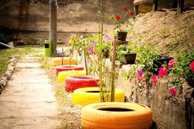tire retaining wall painted tires lined up against a retaining wall in a line ready to