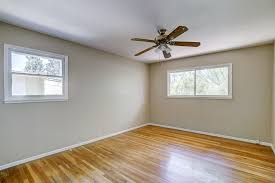 master bedroom with attached private bathroom including hardwood flooring ceiling fan and fresh