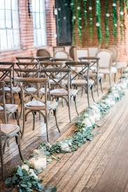 greenery and candles wedding aisle decorations