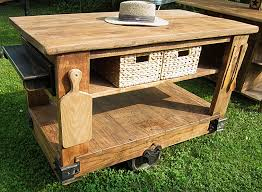 industrial style of reclaimed wood kitchen island on wheels added by butcher nook and rattan storage basket idea