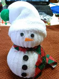 and here is the finished product snowman 1 was made using a mans crew sock snowman 2 was made using a baby crew sock