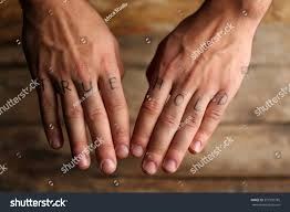 Tattoo Inscriptions On Male Fingers Drawn Stock Photo Edit Now