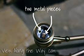 metal pieces on inside of lightbulb socket