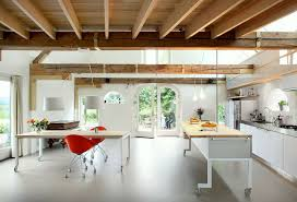 both the modern kitchen island and the dining table can be moved in this modern interior as they both have wheels on the bottoms of them making it easy to