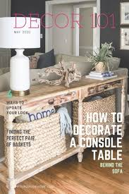 style a console table behind a couch
