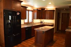 glamorous vinyl plank flooring trend other metro traditional kitchen decorating ideas with black and stainless steel appliances custom made cherry cabinetry