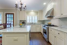 l shaped kitchen with cream cabinets and island