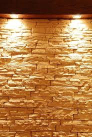 stone wall washed with lights stock image of unshaped stone wall with spot lights homeowner design ideas lampor