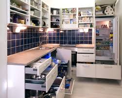 file white kitchen with cabinet doors and drawers opened or removed so that real