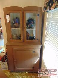 wooden china cabinet 2 glass doors on top with one wooden door on bottom