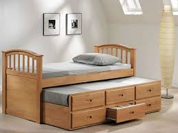 inspiring twin bed with storage added in attic bedroom with double skylights attic bedroom furniture
