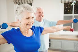 seniors can benefit from physical activity com two elder adults performing exercises small hand weights