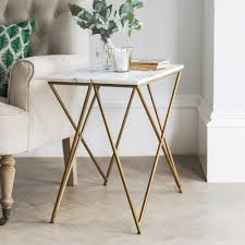 stellar white marble coffee table with gold legs