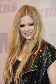 avril lavigne is still rocking her punk look with this heavy smoky eye