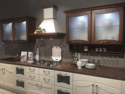 glass cabinet fronts aren t only for wall mounted furniture your lower units can have this feature too