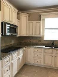 white painted kitchen cabinets. Creamy Off White Painted Kitchen Cabinets With Brown Glaze. Gorgeous Granite And Tumbled Travertine Tile