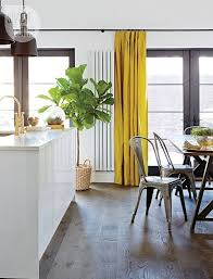 not generally one for yellow but i love the saffron curtain w the charcoal