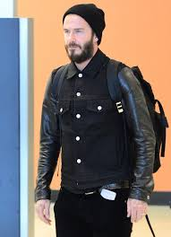 david beckham travels in style as he unveils a leather denim jacket from his belstaff