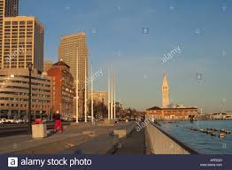 path san francisco office. person jogging and office buildings on embarcado waterfront sidewalk path downtown san francisco bay area california s