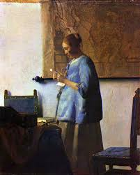 compare his paintings woman in blue reading a letter