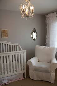 stunning chandeliers for nursery 5 casual armchair closed window plus nice curtain model near small mirror on pastel grey wall paint white crib and cool