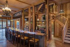 alluring country wine bar with wood elements also illuminated bottle shelves