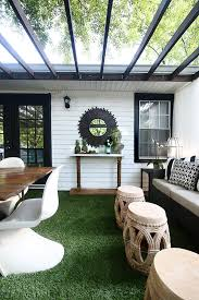 a backyard deck with a diy console table an outdoor furniture set and artificial grass