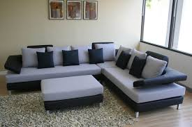 Black Sofas for Modern Living Room Interior : Cozy Living Room Atmopshere  With Black Sofas Design Idea Equipped With Wooden Flooring With Gr.