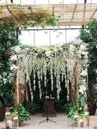 indoor wedding arches. a beautiful birch and willow branch wedding arch draped in flower garlands indoor arches r