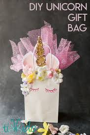 unicorn gift bag made out of a plain white paper gift bag with a flower