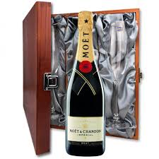 moet chandon brut imperial chagne bottle in moet gift box and flutes in luxury