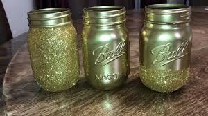 diy spray painted mason jars with glitter