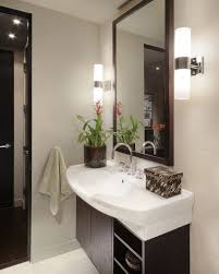 contemporary wall sconces bathroom. wonderful contemporary modern tube wall sconces installed in the bathroom with white sink and contemporary y