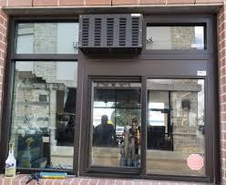 front glass man installing window in houston tx