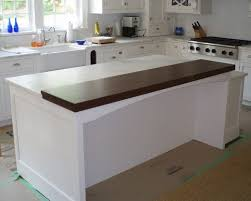 premium wide plank walnut raised bar wood countertop in a bright white kitchen