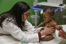 flint water crisis a visual essay a community responds dr mona hanna attisha a pediatrician at hurley medical center and assistant professor at michigan state university looks over isabella evans during her