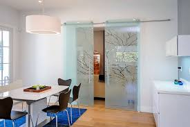 etched glass sliding doors give the classic barn style door a stunning modern reinterpretation from