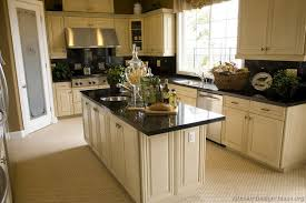 white kitchen cabinets with black countertops. 27 Antique White Kitchen Cabinets [Amazing Photos Gallery] - ThefischerHouse With Black Countertops D